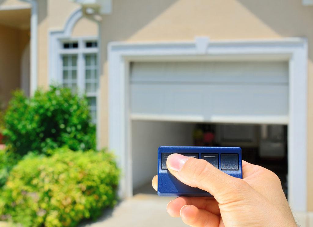 Garage Door Opener opening a residential garage door.
