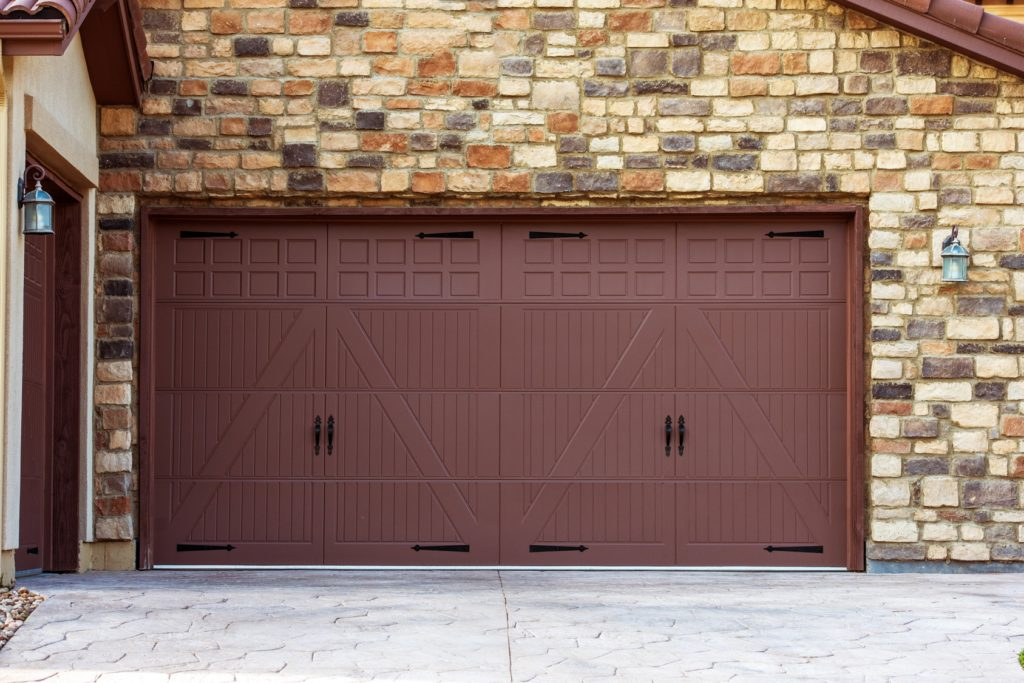 Wide Garage Doors. Brick Wall Garage. Residential Architecture.