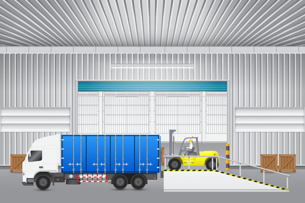 Forklift transfer wood crate into truck with factory background.